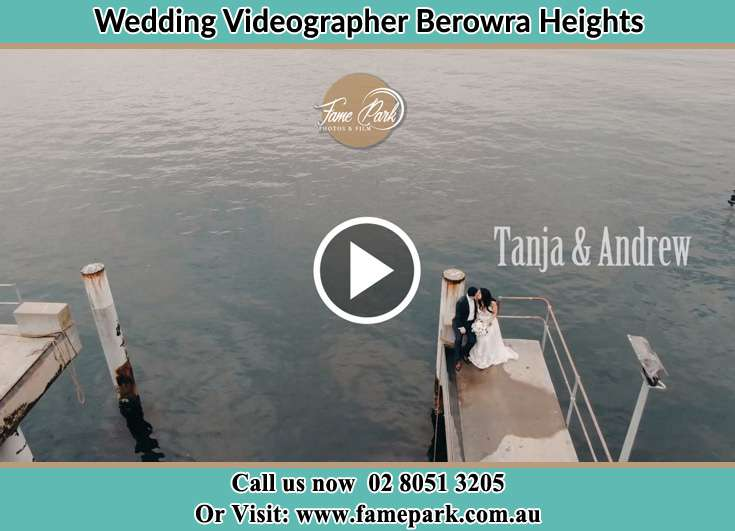 Bride and Groom kissed at the bay while sitting Berowra Heights NSW 2082