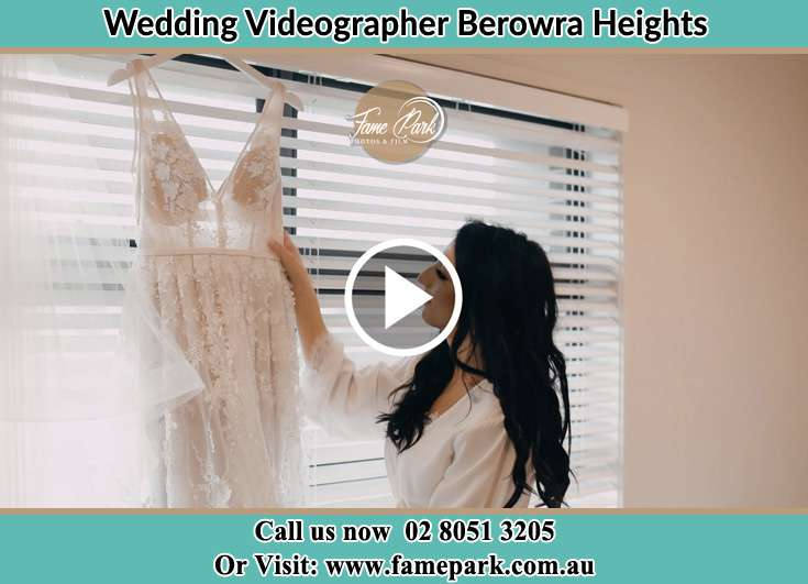 Bride looking her dress Berowra Heights NSW 2082