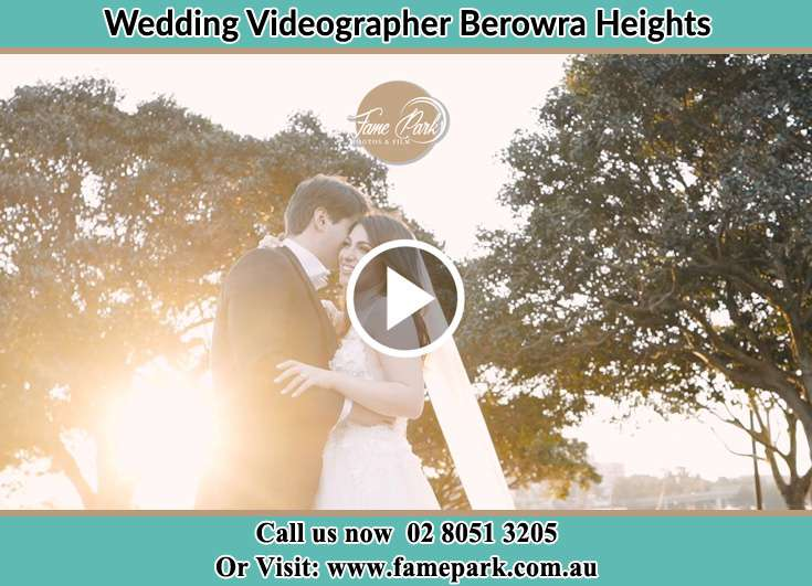 Bride and Groom holding each other at the park Berowra Heights NSW 2082