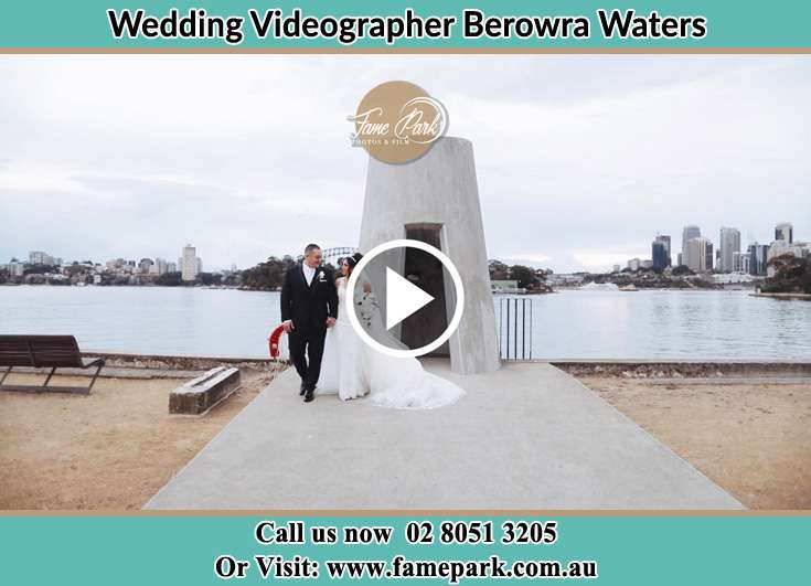 Bride and Groom walk near the shore Berowra Waters NSW 2082
