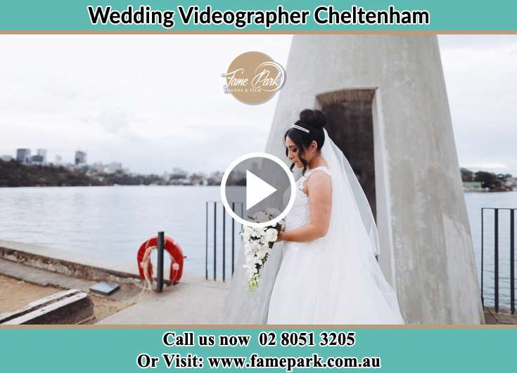 Bride standing near the bay holding a bouquet of flowers Cheltenham NSW 2119