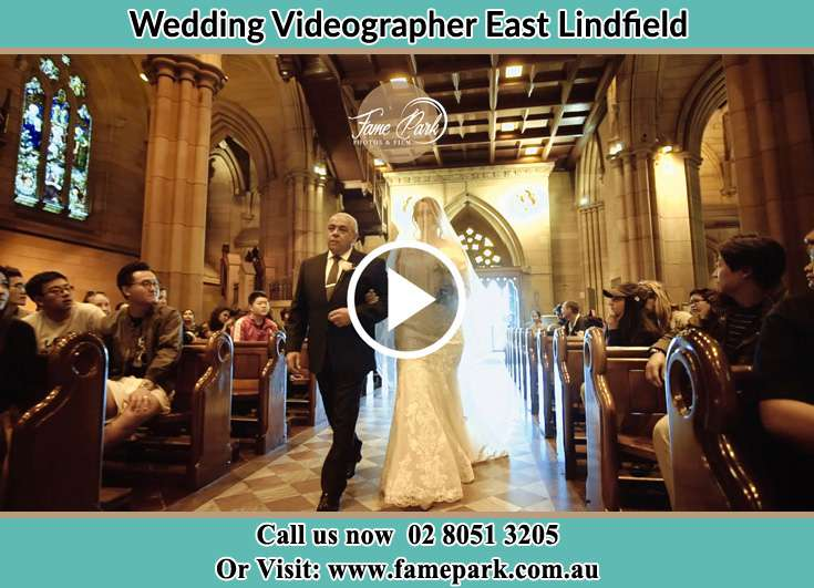 Bride and her father walking in the aisle East Lindfield NSW 2070