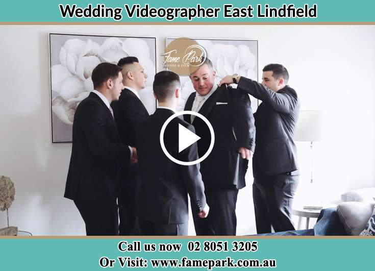 Groom getting ready with his secondary sponsors East Lindfield NSW 2070