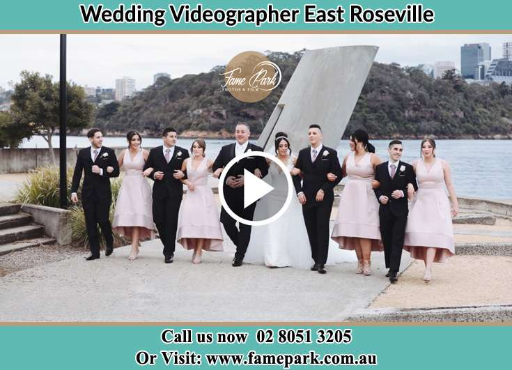 The newlyweds and the entourage walking away from the shore East Roseville NSW 2069