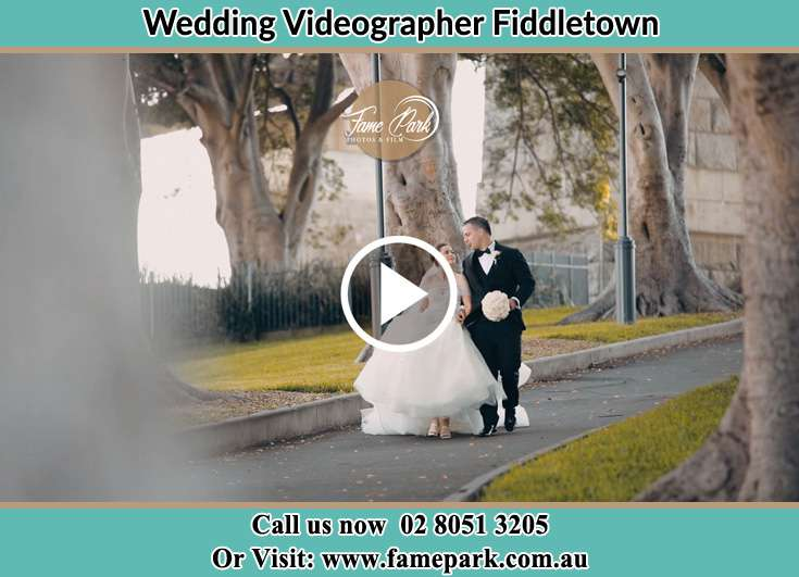 The Groom and the Bride walking in the park Fiddletown NSW 2159