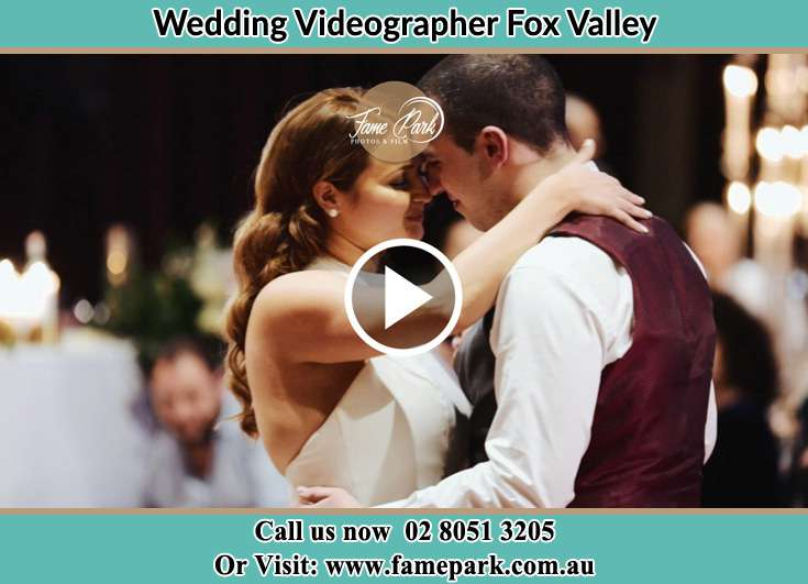 Bride and Groom looking at each other while dancing Fox Valley NSW 2076