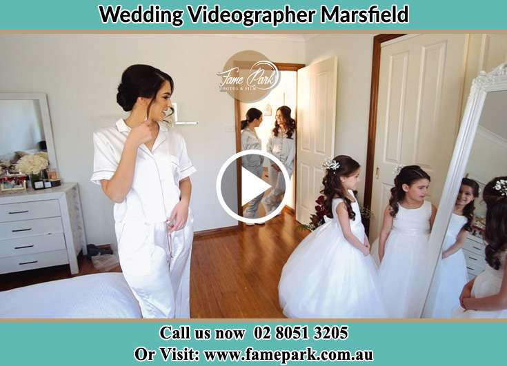 Bride looking at the mirror with her secondary sponsors Marsfield NSW 2122