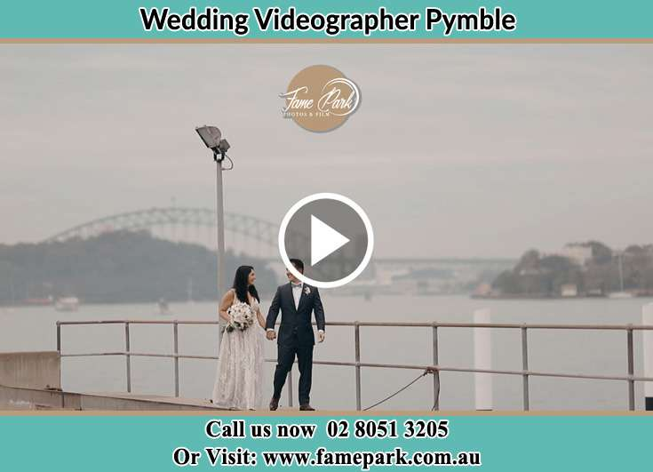 The Groom and the Bride walking near the shore Pymble NSW 2073