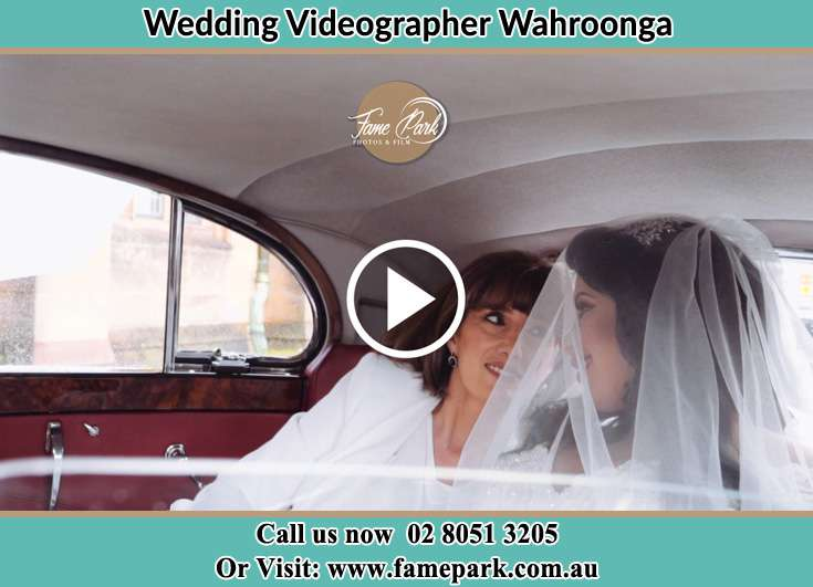 The bride inseide the bridal car with her Mom Wahroonga NSW 2076