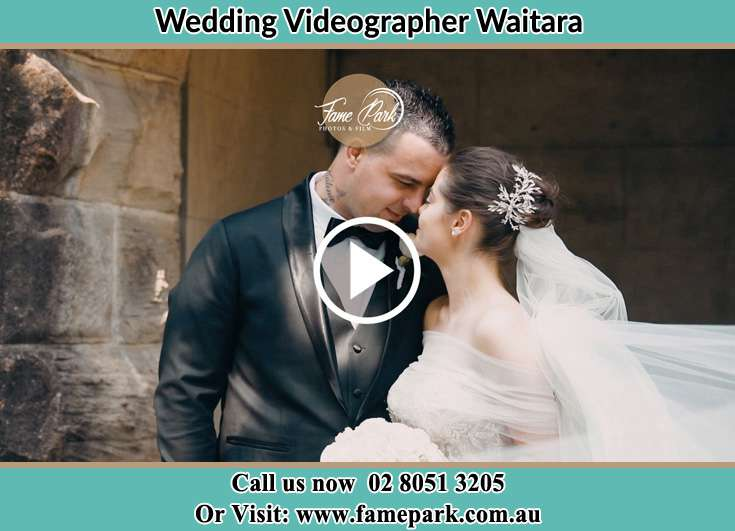 The bride and the groom kissing Waitara NSW 2077