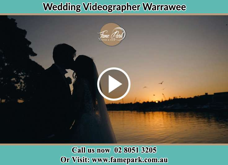 The newlywed kissing during sunset Warrawee NSW 2074