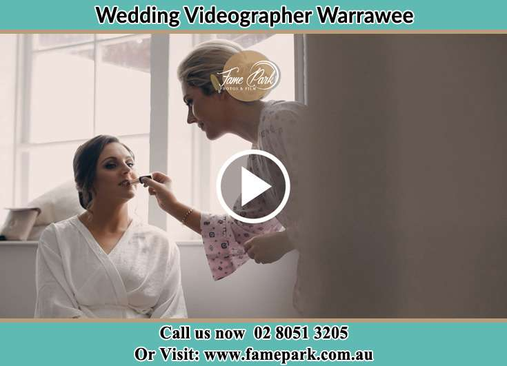 The bride preparing for her wedding with the help of a makeup artist Warrawee NSW 2074