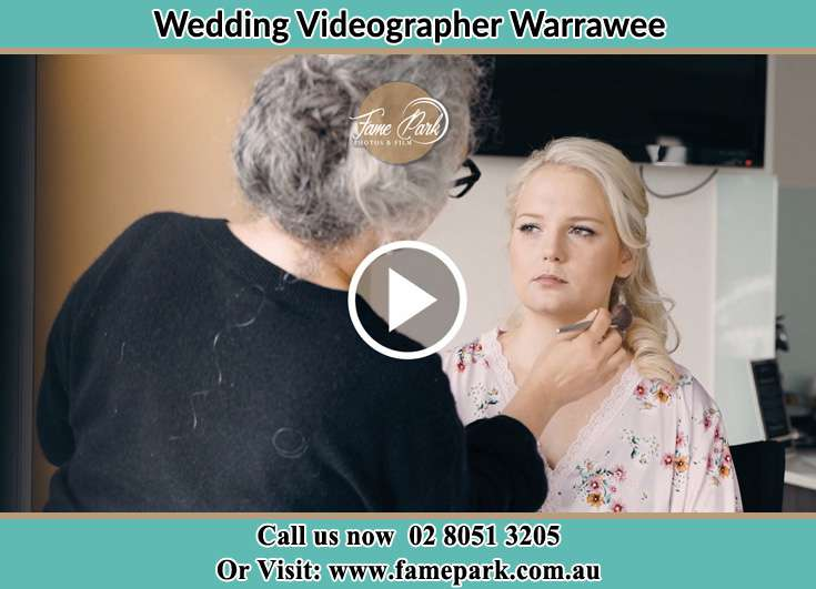 The makeup artist doing her job to the bride Warrawee NSW 2074