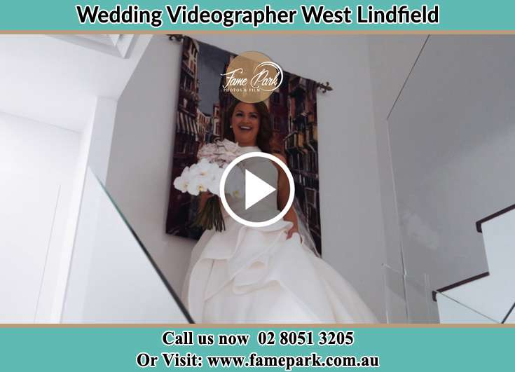 The bride going down the stairs West Lindfield NSW 2070
