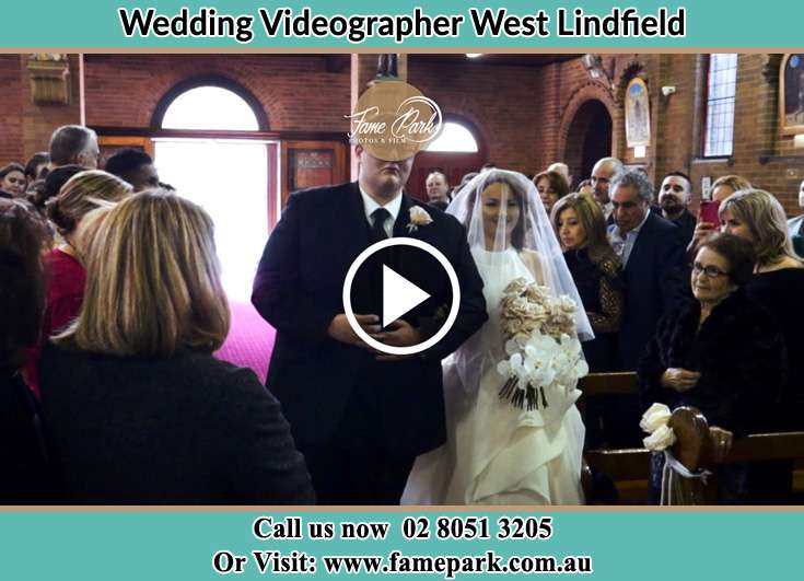 The bride walking down the aisle with her father West Lindfield NSW 2070